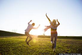 couple jumping in sunlight